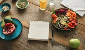 Healthy food with a journal for tracking.