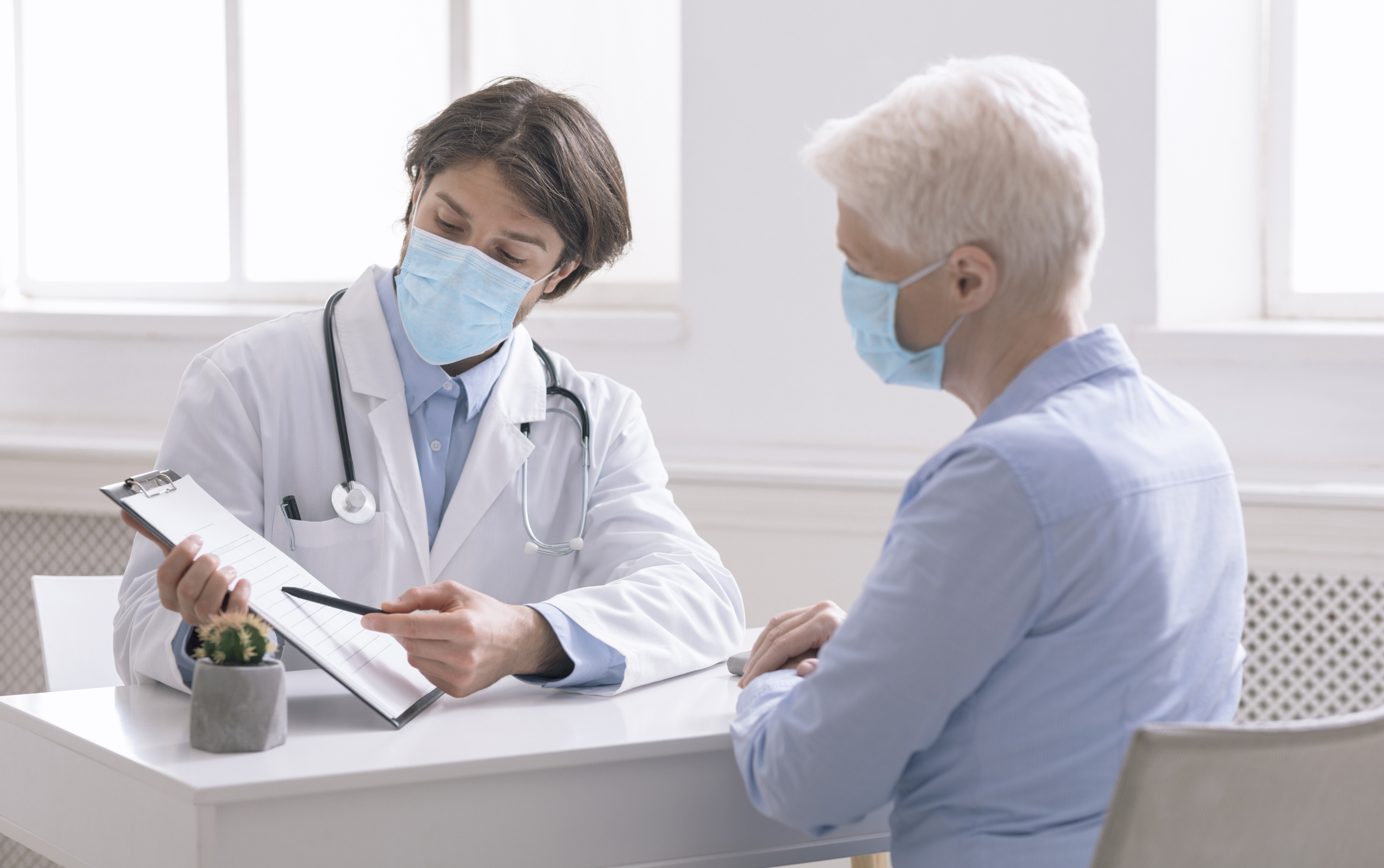 Medical professional reviewing information with a patient.